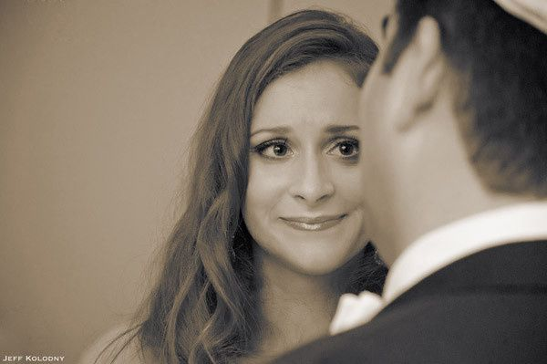 Photo-Journalistic image of brides face captured during her wedding ceremony.  This photo was taken...