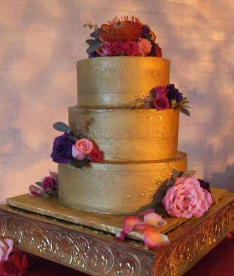 Gold Wedding Cake: Deep Chocolate Cake, Lingonberry Jam ribbon, Raspberry Ganache filling and...