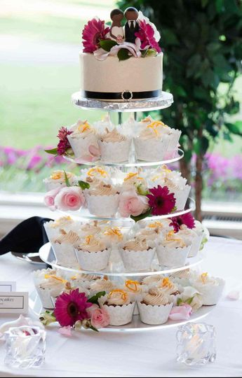 Wedding Cake and Cupcakes: Pineapple Cake, Crushed Pineapple filling, and Ginger Buttercream....