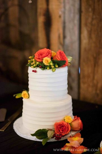 Orange Bubbly Cake with Lingonberry ribbon, Midnight Ganache filling, and fondant frosting. Photo by...