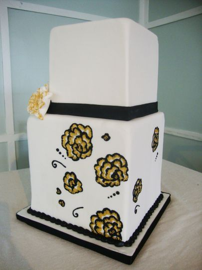 Hand painted fantasy flowers, as well as a hand sculpted fondant fantasy flower, and a black fondant...