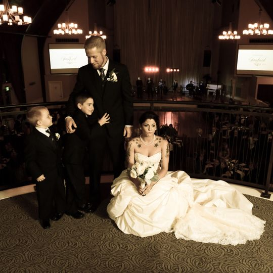 The flower girl, the bride's daughter, decided she wanted nothing to do with the portrait photos. We...