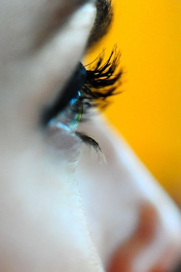 We capture the details that others miss. The groom loves this close-up of his bride's eye makeup.