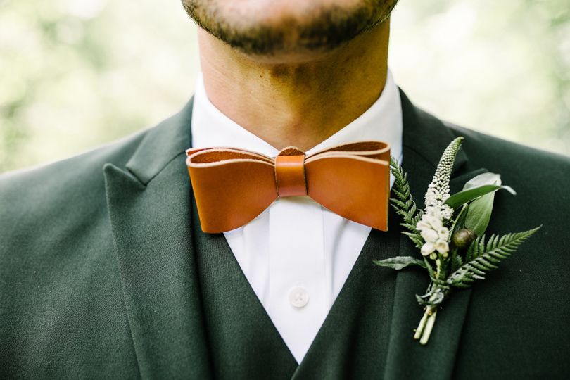 Leather bow tie and boutonniere