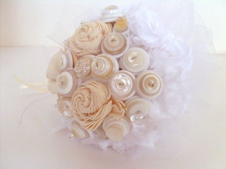 Shabby chic button bouquet with carved wood roses.  Lovely with tulle and ribbons.