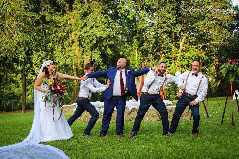 Newlyweds with groomsmen