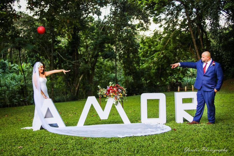 """Newlyweds and """"amor"""" signage"""