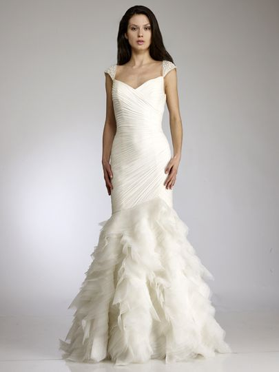 Dora  Draped silk chiffon gown with beaded cap sleeves and tiered organza skirt.