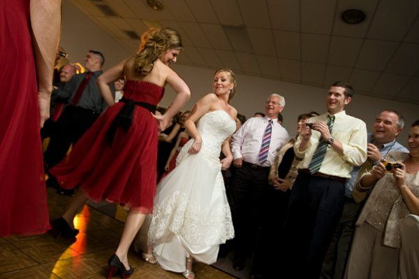 The bride and their guests dancing