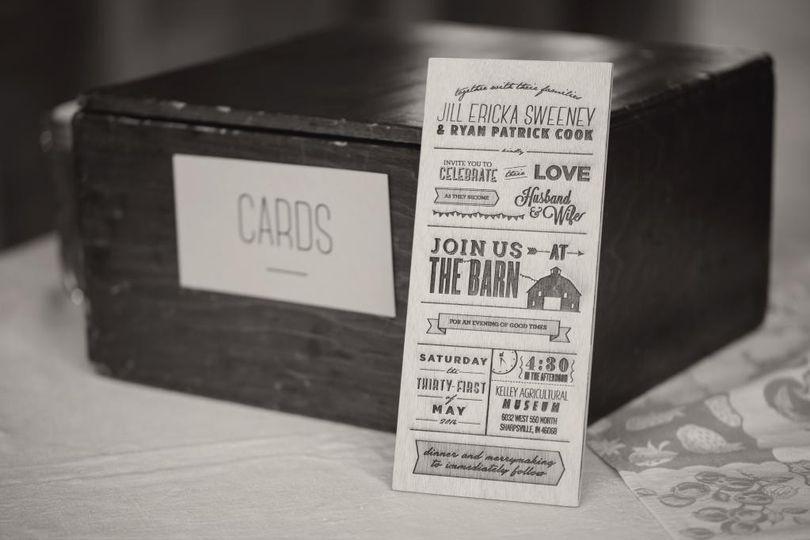 Custom laser cut and engraved wood or acrylic wedding invitations.