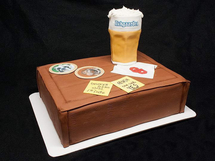 A Grooms cake with some of the grooms favorite things including edible picture coasters of his dogs,...