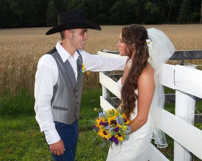 Groom and bride by the field