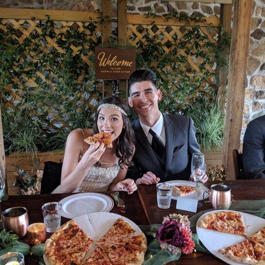Newlyweds having pizza