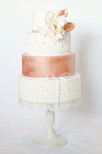 Four tier white and rose gold cake