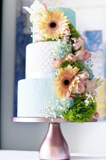 Three tier wedding cake with sunflowers