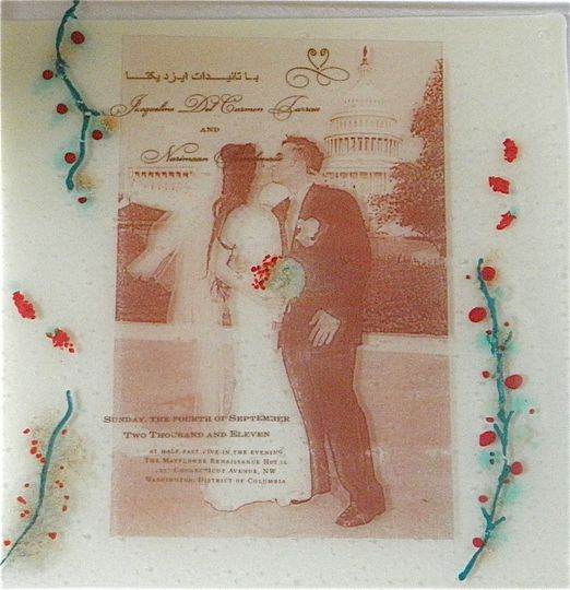 Fused glass piece of the couple, and part of their invitation information