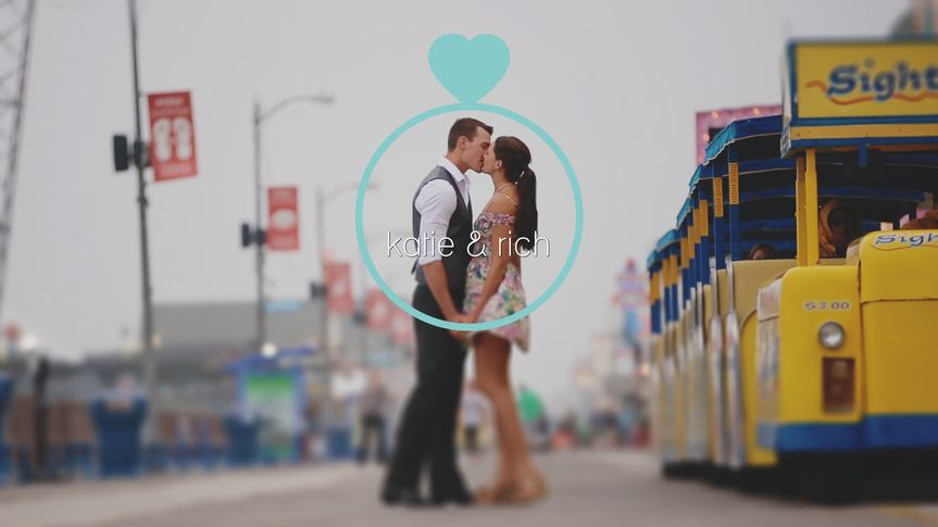 Couple kissing beside a tram