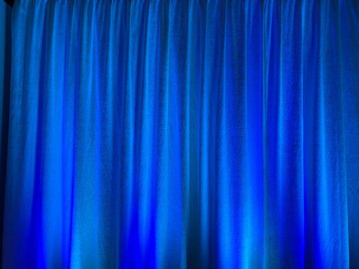 Blue uplights on drapery