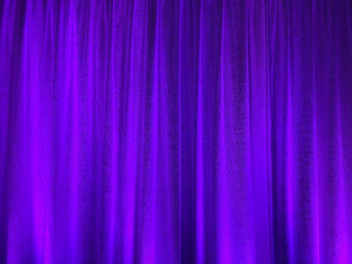 Lavender uplights on drapery