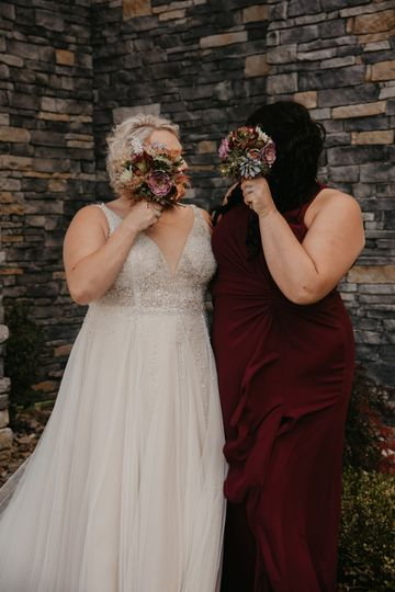 Holding their bouquets - Prime Legacy Photography