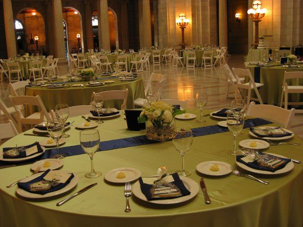 Round table setting with green linen