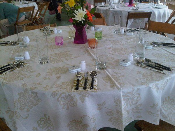 Round table setting with white linen