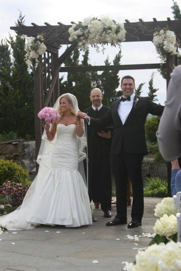 Rev. Louis Consealatore officiating the wedding of 2-Time NFL Pro-Bowler Zak DeOssie and his lovely...