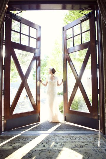 The Heritage Room features wooden doors for a striking grand entrance