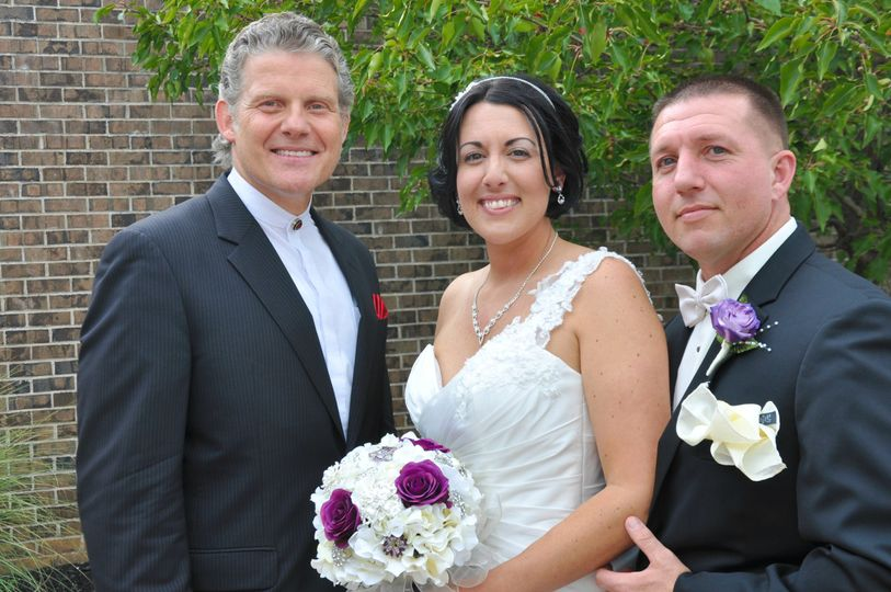 The reverend with the newlywed couple