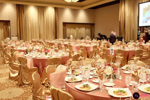 Gold Satin Knot Chair Covers and napkins with Gold/Fuscia Galaxy Linens
