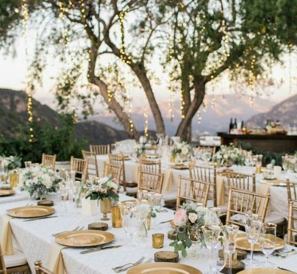 Outdoor reception with gold motif