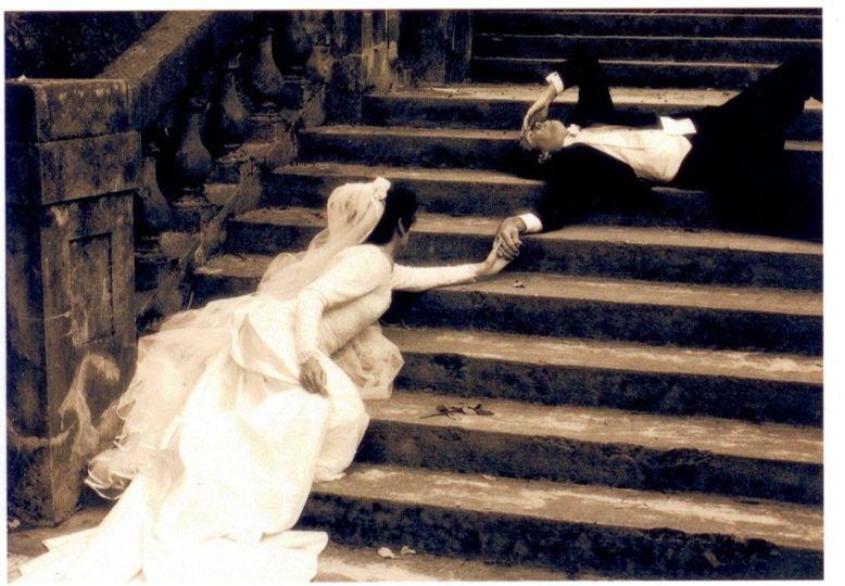 vintage bride and groom on stairs