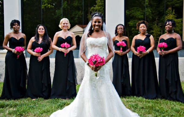Bride and Maids with bouquets of pink roses, calla lilies and berries.