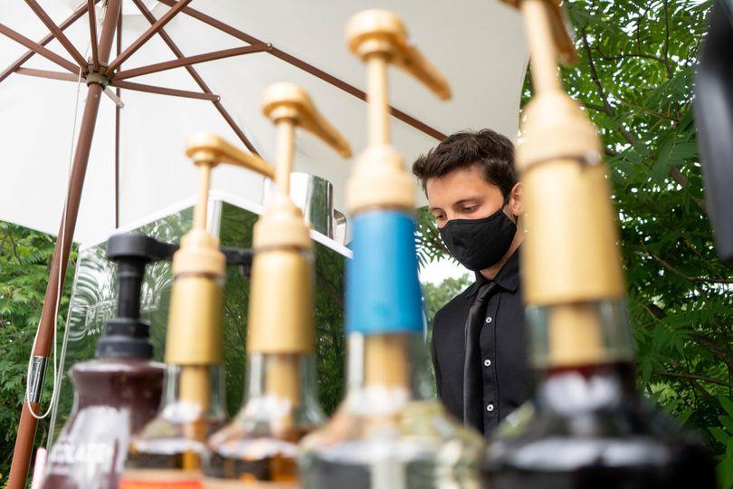 Masked barista at work