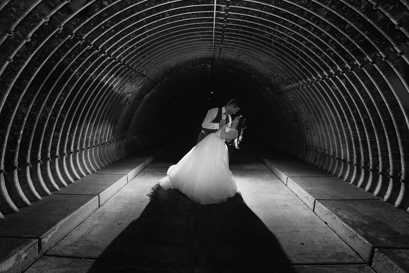 4d6bd1c4e23fcea8 Bride Groom Backlit Tunnel Dipping Black White 1