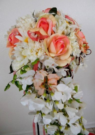 Brides bouquet, life touch roses, lots of daisies and wysteria cascad with ivy strands, lace,...