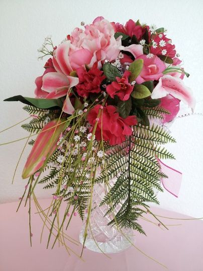 Hot pink stargaziers, azleas, babys breath, and peonies make this bouquet one you want to carry....