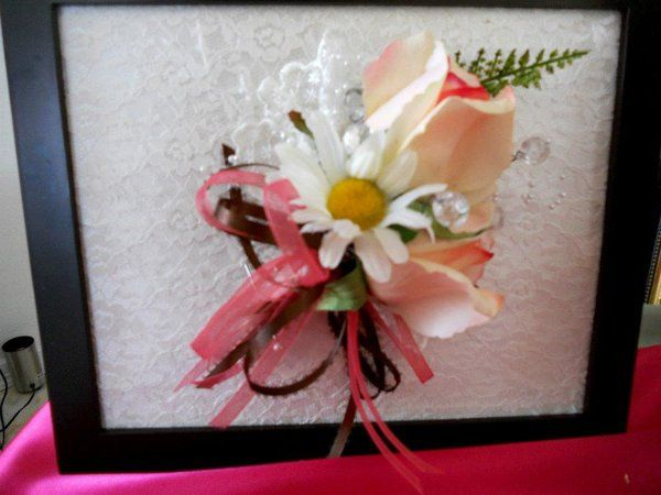 Mom's corsage.  Life touch rose with daisy, accented with victorian lace and brown, pink ribbons