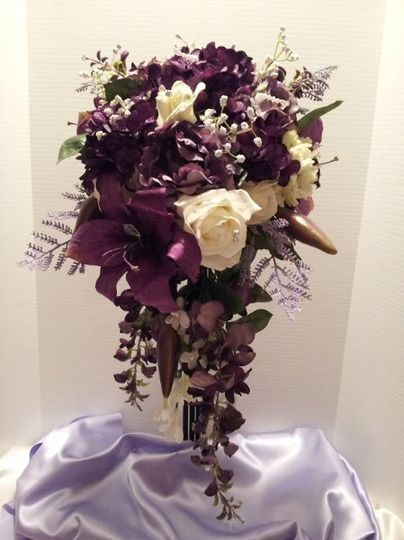 Royal brides bouquet.  Full of Stargaziers, roses, peonies, wysteria,and hydrangeas.  Total length...