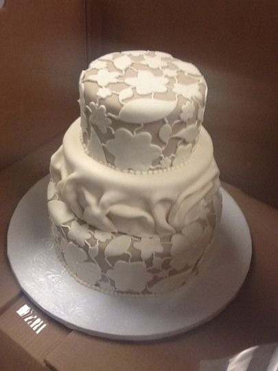 tier lacey cake with fabric 2nd tier ivory beig