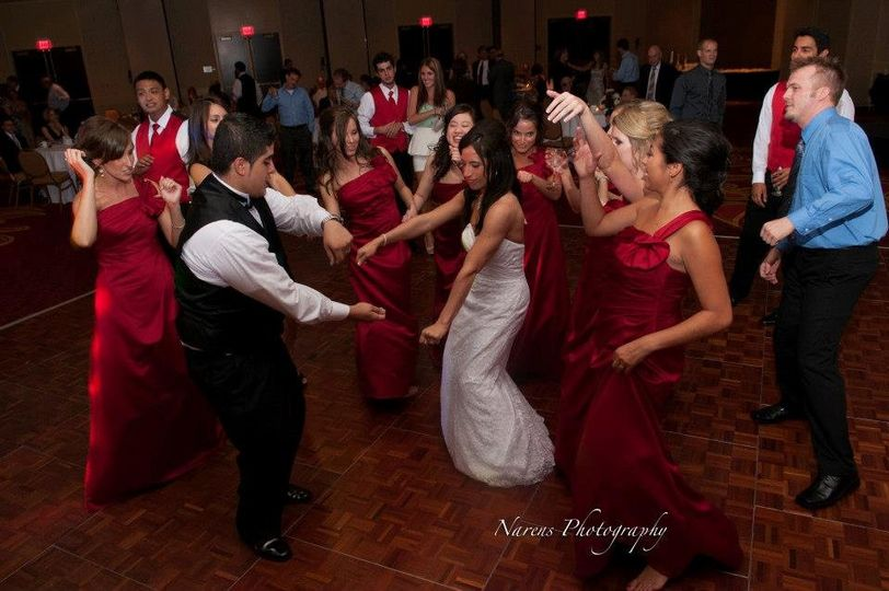 Couple with their guests' dancing