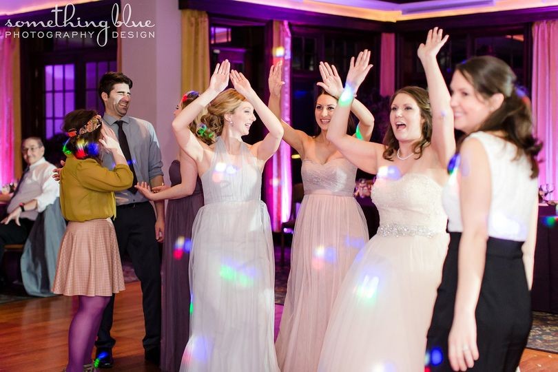 Bride with her bridesmaid dancing