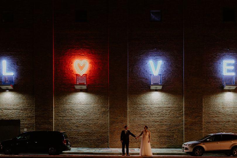 Bride and groom under love sig