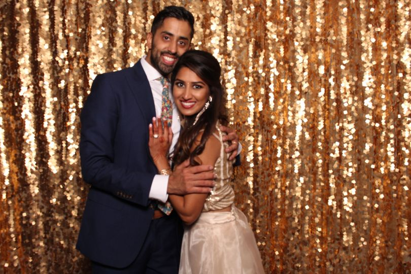 Couple photo with sparkly gold backdrop