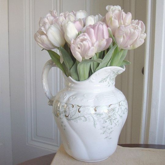 Antique ironstone pitcher filled with tulips