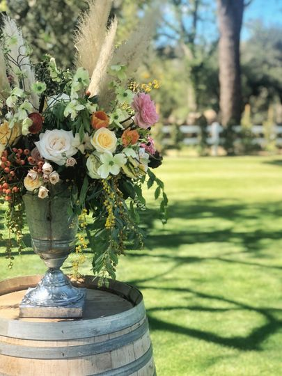 Wild, rustic altar arrangement - royal bee florals and events