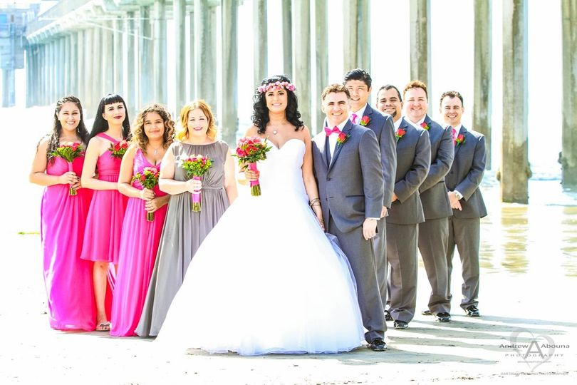 bride in princess wedding dress bridesmaids in red