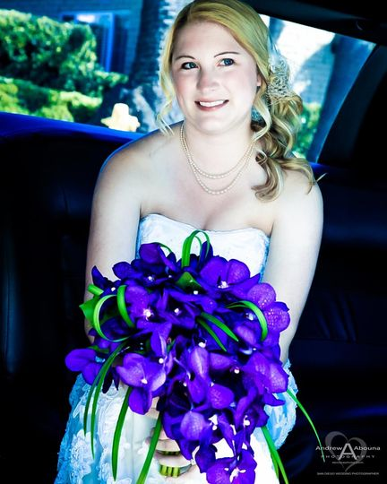 wedding bouquet with purple orchids and bride with