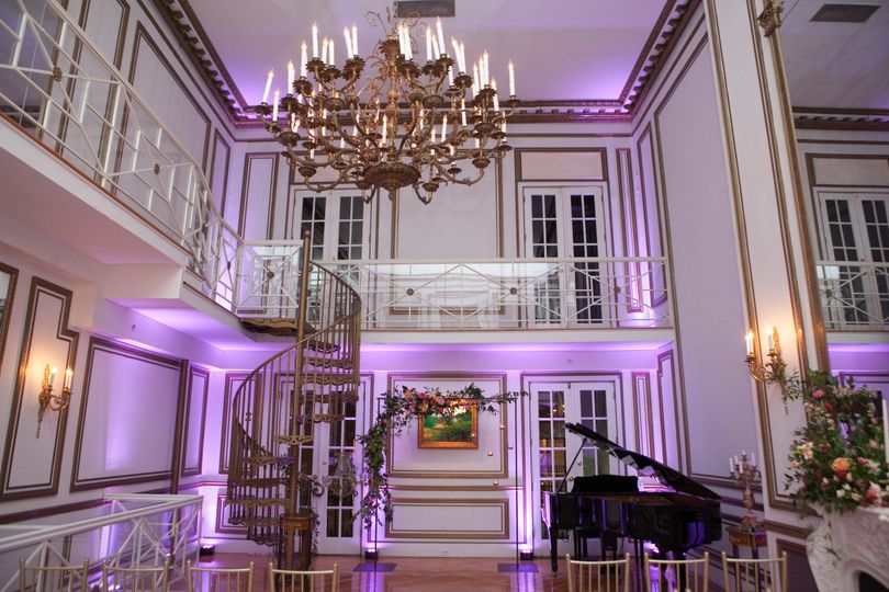 Dramatic lighting in the Grand Salon highlights the beauty of the room