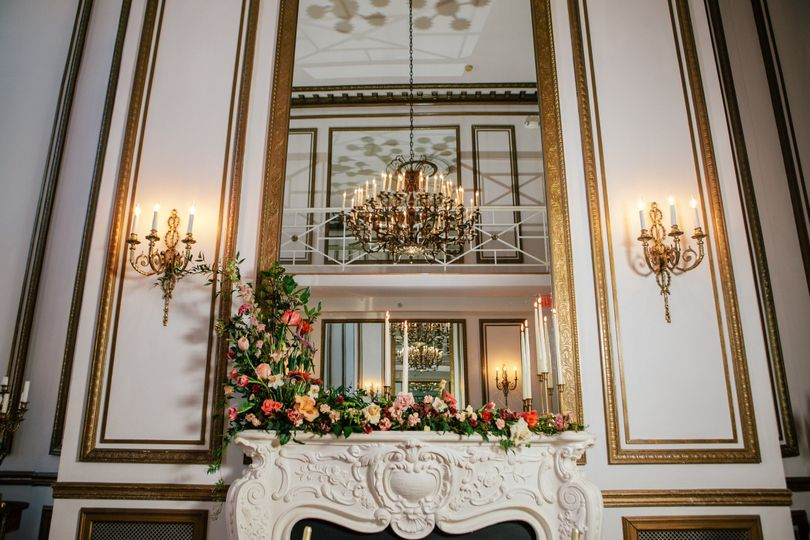 The fireplace in the Grand Salon decorated with beautiful arrangements